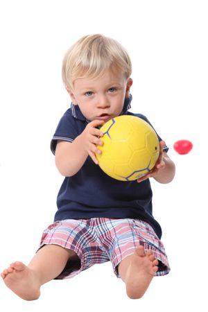 depositphotos 11848513 little boy holding football