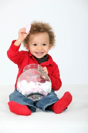 depositphotos 14716397 little boy eating sweets