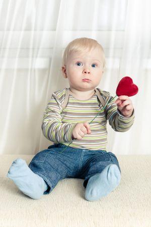 depositphotos 1895616 little boy with heart