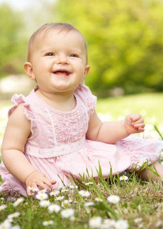 depositphotos 24441587 baby girl in summer dress sitting in field