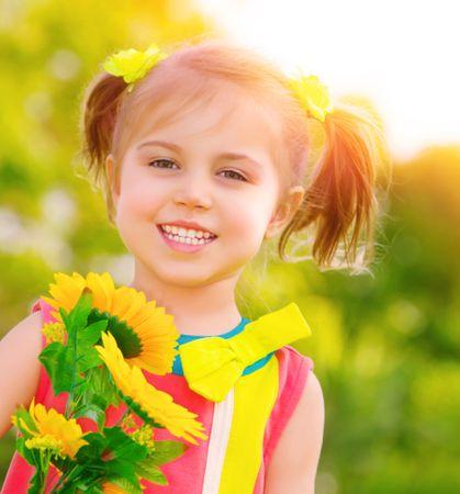 depositphotos 27719621 happy little girl with sunflowers