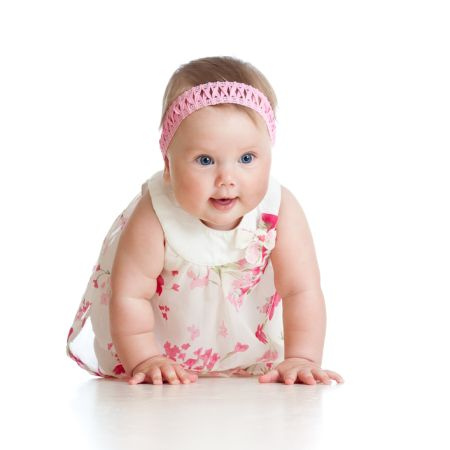 depositphotos 12183413 pretty crawling baby girl isolated on white background