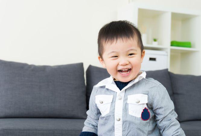 depositphotos 38451609 asian little boy feel happy