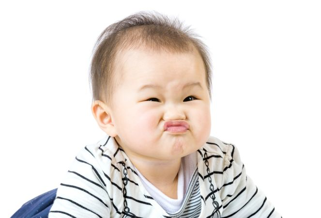 depositphotos 38452175 baby boy purse lip