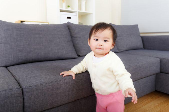 depositphotos 45136269 asian baby girl at home