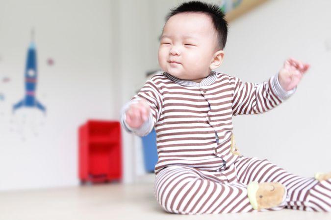 depositphotos 8751073 cute baby happy close his eyes