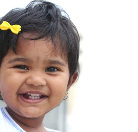depositphotos 11457603 photo of pretty and happy indian baby girl with expressive eyes