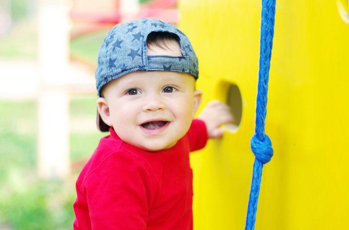 depositphotos 34891785 happy baby boy on playground in summertime