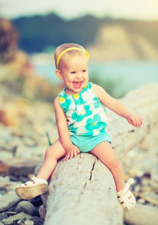 depositphotos 36939999 cheerful happy baby girl laughing on walk in nature
