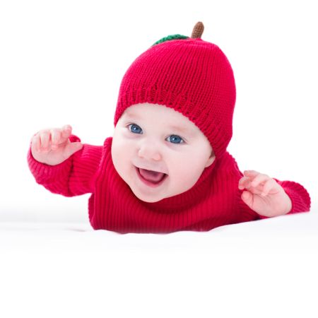 depositphotos 43249615 baby wearing a knitted red apple hat