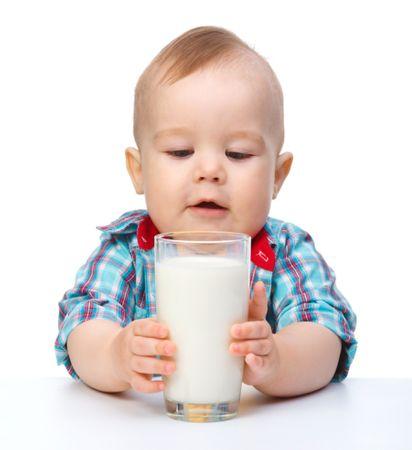 depositphotos 5414421 cute little boy is holding big glass of milk