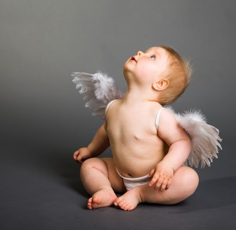 depositphotos 10997263 infant baby with angel wings on neutral background