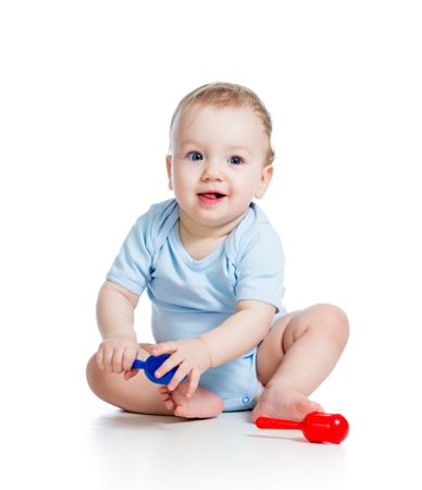depositphotos 28902091 smiling boy baby with musical toys isolated on white backgroun