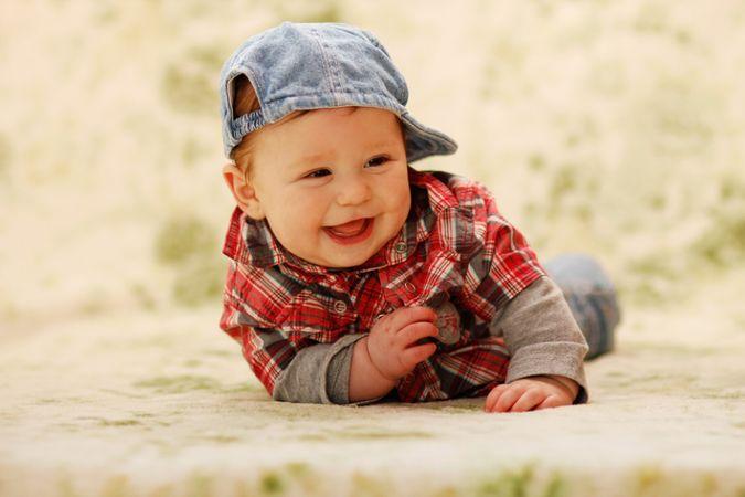 depositphotos 67356067 baby boy laying